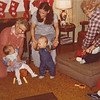 Julie Yaden (sitting in chair) - 1978 (Dec) - Age 24 - With Danny (standing center, age 8 mos) during Christmastime visit at the Selah farmhouse - Also in picture are Danny's Great Aunts Evelyn (left) and Harriett (right), as well as 1st couisn Jennifer Owen (left, age 10 mos) and 2nd cousin Allen (sitting on footstool) - Selah, WA