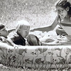 """Julie Yaden - 1984 (July) - Age 30 - With Danny (age 6), Matthew (age 3), and pregnant with Jacob at the Ahtanum Youth Park  - Photo appeared in the July 5 edition of the Yakima Herald Republic - Yakima, WA<br /> <br /> The caption to the newspaper photo read:<br /> <br /> """"Room for everyone --- Julie Yaden brought a pool along to Ahtanum Youth Park to let her sons Danny, 6, and Matthew, 3, cool off in.  But as the July Fourth temperatures reached 87, she couldn't resist jumping in herself."""""""