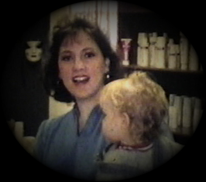 Julie Yaden - 1986 (Jan) - Age 31 - With Jacob (age 15 mos) for his first haircut at the Sir Cut Family Hair Care Center - Selah, WA (Captured from 8mm Film)