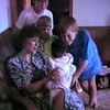 Julie Yaden - 1990 (Aug 31) - Age 36 - Julie introduces Alex (age 5 mos) to the boys - Danny (back, age 12), Matthew (right, age 9), Jacob (center, age 5) - Beaton Lakes Estates Home - Corsicana, TX  (Captured from VHS Video Tape)