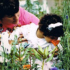Julie Yaden - 1992 (August) - Age 38 - Helping Alex (age 2 1/2) smell the wild flowers in the front yard of the Spanaway home - Spanaway, WA