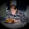 Julie Yaden - 2003 (March 18) - Age 49 - Julie blows out the candles in celebration of her 49th birthday - Storm Mountain home - Drake, CO