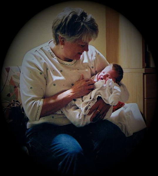 Julie Yaden - 2007 (May 25) - Age 53 - Holding new grandson Jacob Benjamin Yaden, Jr. (born May 24) - McKee Medical Center - Loveland, CO