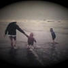 Matthew Yaden (center) - 1983 (July) - Age 2 - With Mom (Julie) and Danny (age 5) on a cold July day at the beach - Westport, WA (Captured from 8mm film)