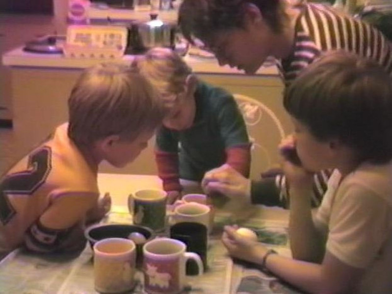 Matthew Yaden (left) - 1987 (April 18) - Age 5 - Coloring Easter eggs with Danny (age 9 in two days), Jacob (age 2), and Mom (Julie, age 33) - Yellow Farmhouse - Selah, WA  (Captured from VHS Video Tape)