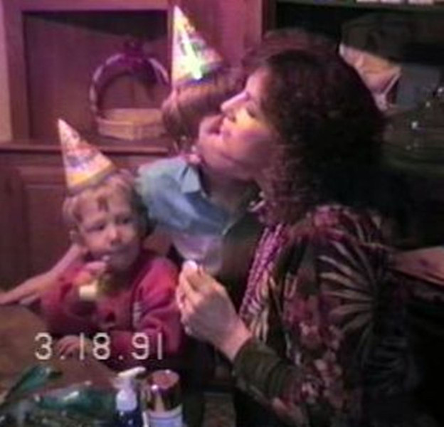 Matthew Yaden - 1991 (March 18) - Age 9 - Matthew assesses the new birthday perfume he bought for Mom (Julie, age 37), while Steven (age 2) observes - Beaton Lake Estates Home - Corsicana, TX (Captured from VHS Video Tape)