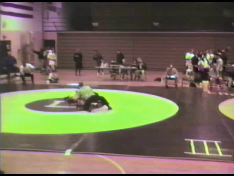 Video Archive Clip 1997 (Jan) - Yaden, Matthew J. - Age 15 - Matt (orange) wrestles for Mansfield Sr. - Jan Match 1 - Mansfield Senior High School - Mansfield, OH - Original VHS Series (5 min 24 sec)