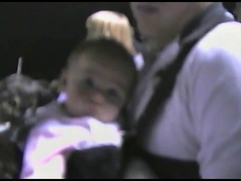Video Archive Clip 2005 (Sep) - Yaden, Matthew J. - Age 24 - With daughter Jaycene (age 9 mos) at Steven's TVHS football game - Ray Patterson Stadium - Loveland, CO - Original VHS Series (52 sec)