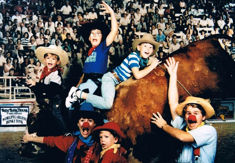 """Steven Ralph Yaden (being held by Mom) - 1989 (June) - Age 13 mos - Family pose with the mechanical bull at Billy Bob's Texas, """"The World's Largest Honky Tonk"""" - (L to R) Jacob (age 4), Mom (Julie, age 35), Danny (age 11), Matthew (age 7), and Dad (Dan, age 35) - Fort Worth, TX"""