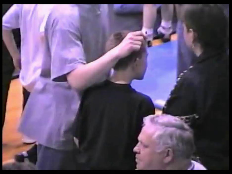 Video Archive Clip 1998 (Apr) - Yaden, Steven R. - Age 9 - Steve (red & blue) wrestles in an open tournament, with big brother Matt (age 16) as coach, big brother Jake (age 13) as personal trainer, and Mom (Julie, age 44) as fan - Mansfield, OH - Original VHS Series (4 min 59 sec)