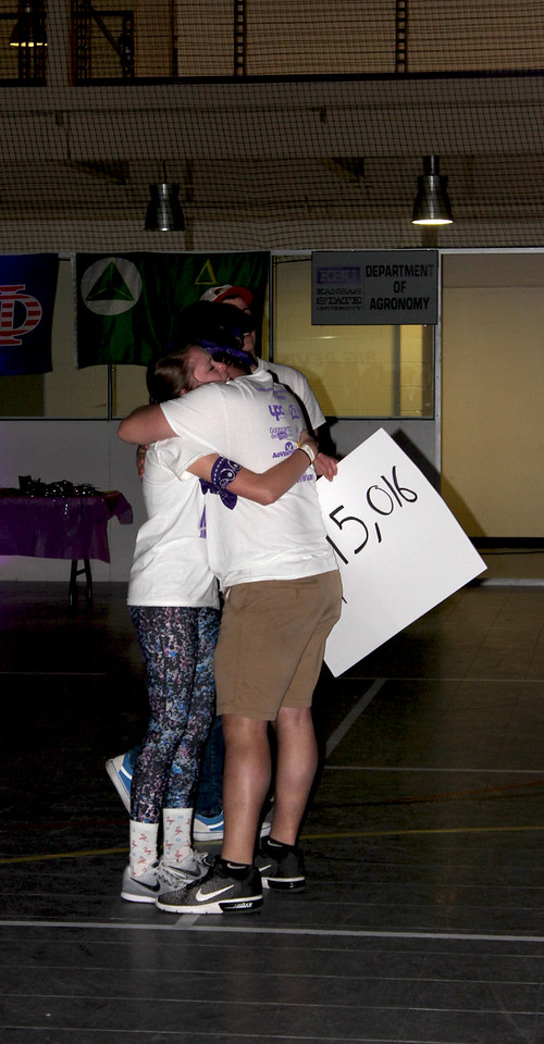 Dance marathon organizers share a hug after the final reveal of the total amount of money raised throughout the day (MOLLY HACKETT | COLLEGIAN MEDIA GROUP)