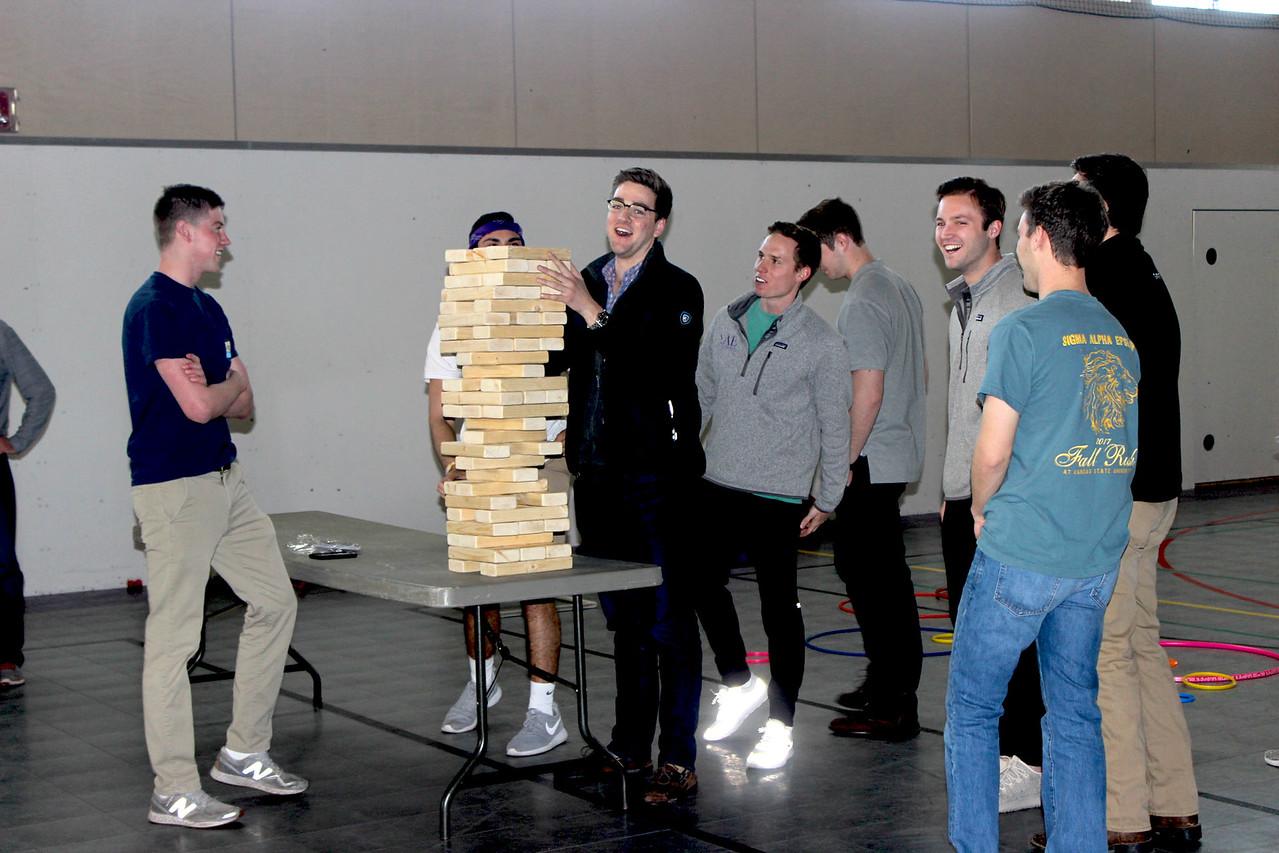 Members of Sigma Alpha Epsilon playing Jenga together. (MOLLY HACKETT | COLLEGIAN MEDIA GROUP)