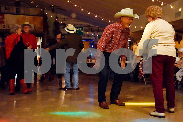 Dwayne Collins, second from right, talks and dances with a friend at Edom City Limits Opry House and Dance Hall in Edom, Texas, on Tuesday, Nov. 7, 2017. The dance hall has hosted live music and two stepping every Tuesday night for seven years, drawing people from all across Northeast Texas. (Chelsea Purgahn/Tyler Morning Telegraph)