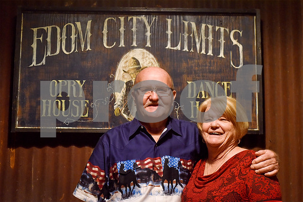 John and Linda Thompson pose for a photo at Edom City Limits Opry House and Dance Hall in Edom, Texas, on Tuesday, Nov. 7, 2017. The two met at the dance hall around Valentine's Day in 2011 and were married Aug. 22, 2017 at Edom City Limits. The dance hall has hosted live music and two stepping every Tuesday night for seven years, drawing people from all across Northeast Texas. (Chelsea Purgahn/Tyler Morning Telegraph)