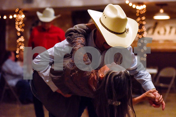 Roy Curtis dips Michelle Titus during a dance at Edom City Limits Opry House and Dance Hall in Edom, Texas, on Tuesday, Nov. 7, 2017. The dance hall has hosted live music and two stepping every Tuesday night for seven years, drawing people from all across Northeast Texas. (Chelsea Purgahn/Tyler Morning Telegraph)