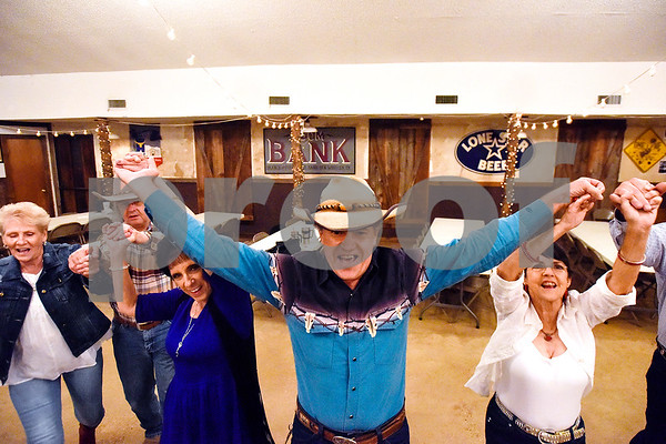 """People dance to """"I Saw The Light,"""" the last song performed Tuesday evenings by Ben Lowery and Texas Express, at Edom City Limits Opry House and Dance Hall in Edom, Texas, on Tuesday, Nov. 7, 2017. The dance hall has hosted live music and two stepping every Tuesday night for seven years, drawing people from all across Northeast Texas. (Chelsea Purgahn/Tyler Morning Telegraph)"""