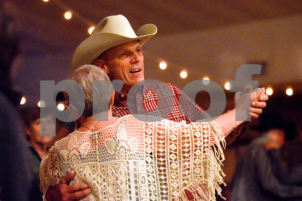 Dwayne Collins dances with a friend at Edom City Limits Opry House and Dance Hall in Edom, Texas, on Tuesday, Nov. 7, 2017. The dance hall has hosted live music and two stepping every Tuesday night for seven years, drawing people from all across Northeast Texas. (Chelsea Purgahn/Tyler Morning Telegraph)