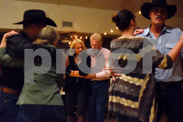 Debbie Hooton and Larry Wheeler, center, dance at Edom City Limits Opry House and Dance Hall in Edom, Texas, on Tuesday, Nov. 7, 2017. The dance hall has hosted live music and two stepping every Tuesday night for seven years, drawing people from all across Northeast Texas. (Chelsea Purgahn/Tyler Morning Telegraph)