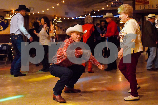Dwayne Collins, center, dances to a rock song at Edom City Limits Opry House and Dance Hall in Edom, Texas, on Tuesday, Nov. 7, 2017. The dance hall has hosted live music and two stepping every Tuesday night for seven years, drawing people from all across Northeast Texas. (Chelsea Purgahn/Tyler Morning Telegraph)