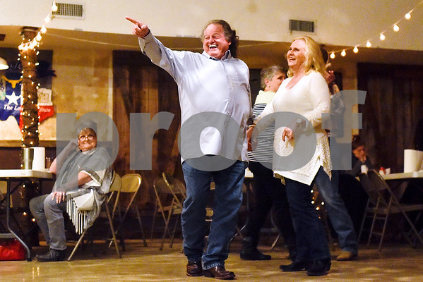 John Rugg points as he and Karen Rugg laugh at a joke made by Ben Lowery and Texas Express at Edom City Limits Opry House and Dance Hall in Edom, Texas, on Tuesday, Nov. 7, 2017. The dance hall has hosted live music and two stepping every Tuesday night for seven years, drawing people from all across Northeast Texas. (Chelsea Purgahn/Tyler Morning Telegraph)