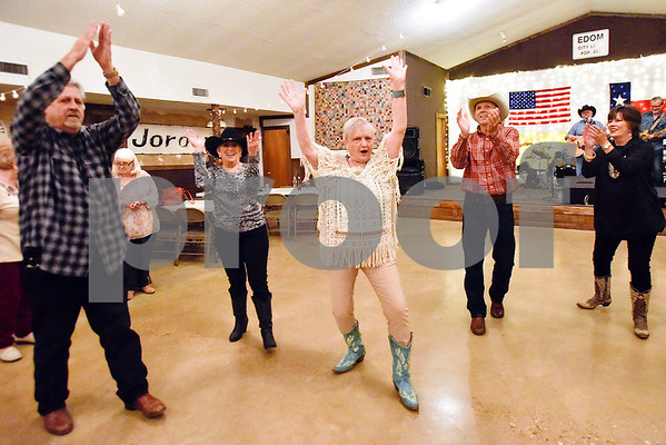 """People clap after """"I Saw The Light,"""" the last song performed Tuesday evenings by Ben Lowery and Texas Express, at Edom City Limits Opry House and Dance Hall in Edom, Texas, on Tuesday, Nov. 7, 2017. The dance hall has hosted live music and two stepping every Tuesday night for seven years, drawing people from all across Northeast Texas. (Chelsea Purgahn/Tyler Morning Telegraph)"""