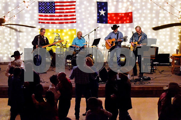 Ben Lowery and Texas Express perform at Edom City Limits Opry House and Dance Hall in Edom, Texas, on Tuesday, Nov. 7, 2017. The dance hall has hosted live music and two stepping every Tuesday night for seven years, drawing people from all across Northeast Texas. (Chelsea Purgahn/Tyler Morning Telegraph)