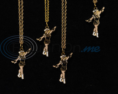 Tyler Junior College Apache Belle Drill Team drop necklaces, signifying a dancers official membership on the team, hang on display during the team's 2019-2020 reveal and performance Friday, Aug. 16, 2019, in the Robert M. Rogers Nursing & Health Science Center in Tyler.   (Cara Campbell/Tyler Morning Telegraph)