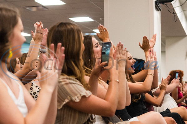 Tyler Junior College Apache Belle Drill Team 71st line alumni cheer on the 72nd and 73rd line of dancers during the team's 2019-2020 reveal and performance Friday, Aug. 16, 2019, in the Robert M. Rogers Nursing & Health Science Center in Tyler.   (Cara Campbell/Tyler Morning Telegraph)