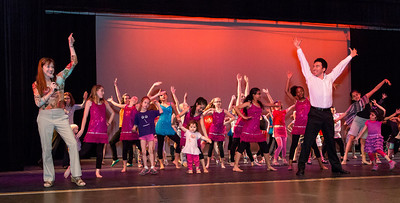 Lucy Bowen McCauley leads youth performers onstage. Move Me Festival Photo by David Moss, 2013
