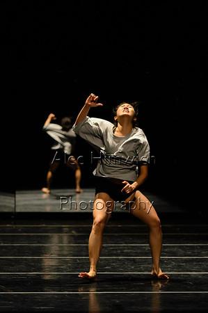 """SPIRAL<br /> Choreographed and danced by Eufern Pan<br /> Music: """"Begin"""" by Jorge Mendez and """"Bowsprit"""" by Balmorhea<br /> Lighting Design by Jesse Belsky<br /> <br /> The struggle for mental health is heartbreakingly prevalent at Duke. I notice it in the loudest of confessions and in the quietest of actions. I dance <br /> tonight to share my story of my battle with body image, but I also dance to testify that I am not alone in my struggle. That you are not alone in yours. <br /> That we are on spiral staircases – that life may seem like a terrible cycle of worthlessness, but in actuality we are moving forward and upward with every <br /> step. And, in spite of everything, that we are beautiful.<br /> <br /> 2015 November Dances<br /> Duke Dance Program<br /> Reynolds Theater<br /> Durham, NC <br /> November 20, 2015"""