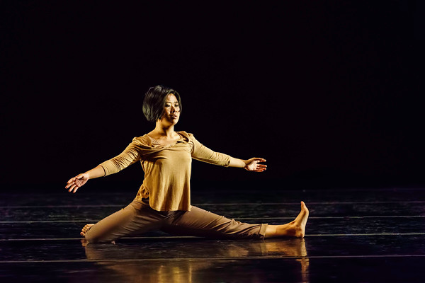 """place<br /> <br /> Choreographed and danced by Cindy Li<br /> <br /> Music: """"(River Water)"""" by (Huaxia Ensemble)<br /> <br /> As people in diaspora, we are always in relation to a sense of origin and location, managing a desire to understand why and where and when, negotiating the space<br /> between """"here"""" and """"there,"""" between """"then"""" and """"now."""" As such, even the act of placing our bodies in a space carries within itself incredible weight.<br /> place as a strategy demands that we think about the movement of our limbs<br /> (however small they may be) as part of long processes of migration, re-orientation,<br /> translocation, and home-making that have shaped our diasporic spaces.<br /> As a choreographic project, place points to our own bodies as the site at which we might begin to understand or remember - in order to place something, do I have to displace something else? Does placement require stability? Do I have to let go? Am I safe?<br /> <br /> Can you see me? Do I have to know where I'm going?<br /> <br /> Choreolab 2018<br /> Duke Dance Program<br /> Reynolds Industry Theater<br /> Durham, NC<br /> April 12, 2018"""