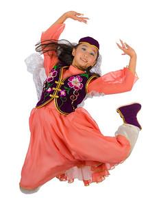 """ZiYuan dances """"Alamuhan"""" which depicts a Xinjiang Uyghur girl."""