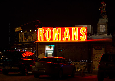 Roman Oasis 's lighted sign on cars 8471