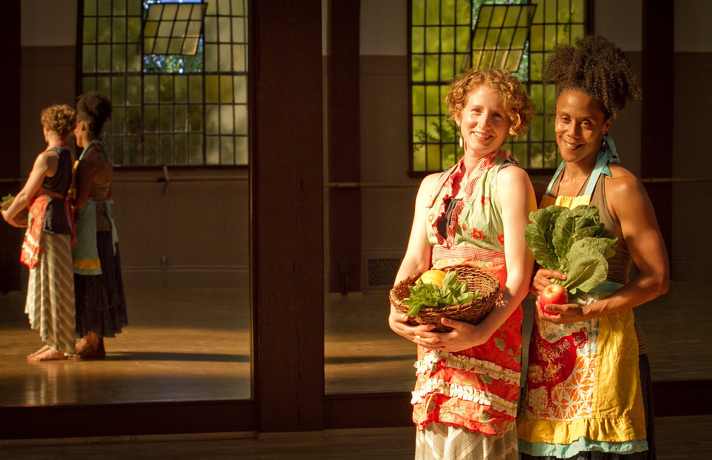 "Amara Tabor-Smith, (African American) and Lisa Wymore hold a basket of vegetables at the UC Bancroft Dance Studio in Berkeley, Calif., on Friday, August 24th,  2012. They are holding a dance work shop called ""From the Field to the Table"" that involves food and dance."