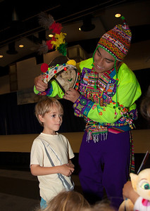 Cayden (age 6) from Frederick MD tries on a hat Tinkus - Pachamama (Bolivia) performed by FC Pachamama