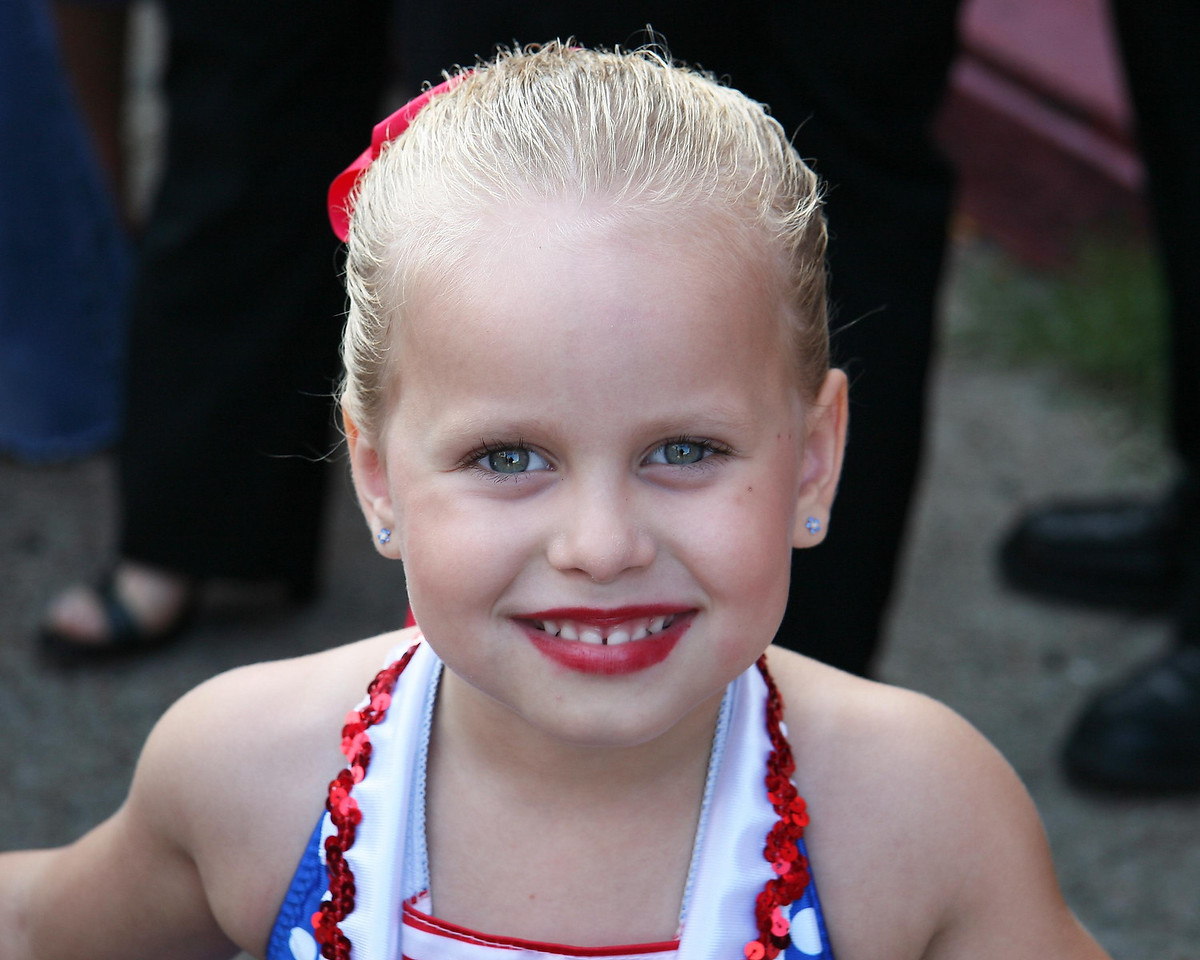 """4 year old Kalie breaking lose after the long awaited for dance recital.  Her dance was to the song """"Good Ship Lolly Pop""""  as sung by Shirley Temple.  You may notice a similarity in the costume.  She was so excited that her friends an family were on hand to cheer for her!"""