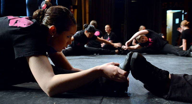 "Sarah Nahrgang (L) and Lansdale Catholic Dance Company members strech before a dress rehearsal of their 22nd Annual Dance Showcase ""Heating Up The Stage"" at Lansdale Catholic High School on Tuesday February 25,2014. Photo by Mark C Psoras/The Reporter"