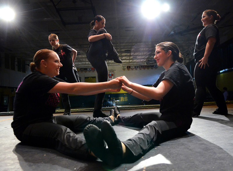 "Lansdale Catholic Dance Company members strech before a dress rehearsal of their 22nd Annual Dance Showcase ""Heating Up The Stage"" at Lansdale Catholic High School on Tuesday February 25,2014. Photo by Mark C Psoras/The Reporter"