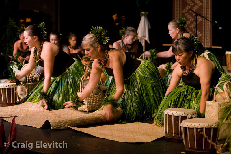 Arranging lauhala mats and implements for Hula Noho.