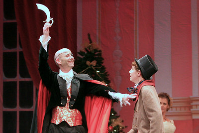 Drosselmeyer presents a toy sword to Fritz.