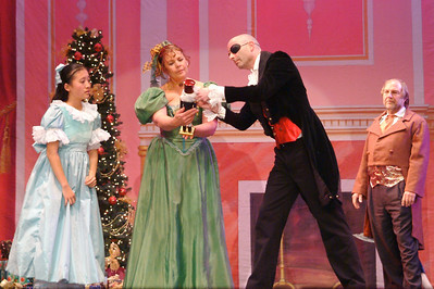 After Fritz stomps on the nutcracker, Drosselmeier repairs it. (Anne Barry photo)