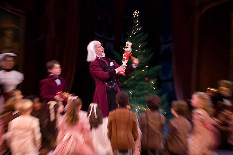 The children gather around Drosselmeir and the Nutcracker