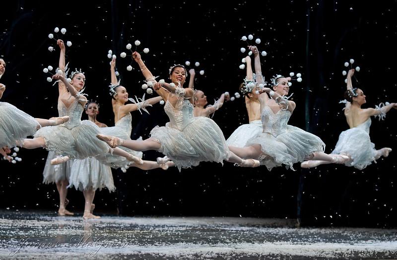 Seven Grande Jete Snowflakes in perfect unison.