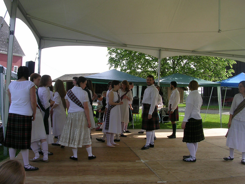 Organizing dancers on the platform at the highland games