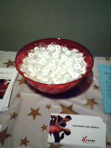 Bowl of mints on the table with the flyers