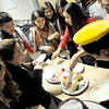 The Tibetan American Foundation Minnesota performers surprise their teacher with a traditional milk cake as a thank you during practice at the Tibetan Center. (Pioneer Press: Sherri LaRose-Chiglo)