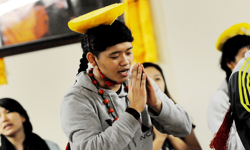 "Tenzin Yeshi Paichang, 20, practices the traditional dance with song "" Choesum"" on Sunday at the Tibetan Center in St. Paul. Paichang, who was the first baby born to Tibetan parents who came to Minnesota in 1992 as part of the Tibetan resettlement project from refugee camps in India.  When Tenzin Yeshi was a toddler, he portrayed the Dalai Lama in the Martin Scorcese film Kundun.(Pioneer Press: Sherri LaRose-Chiglo)"