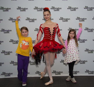 Alexis Mott (age 6) and Nora Schulman (age 7) of Washington D.C. pose with dancer Carmen Salta.