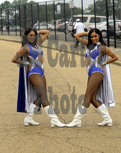 Second year Captain Charlotte (L) poses with her twin sister Charlene (R) before the game.
