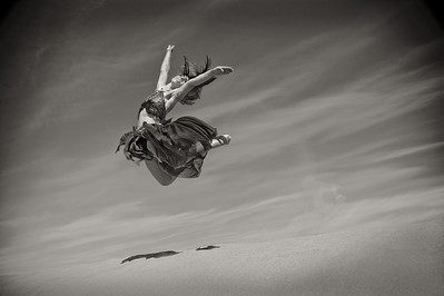 Katie Ponozzo, dancer leaping from sand dune. Bruneau Sand Dunes, Idaho. Photo by Mike Reid.